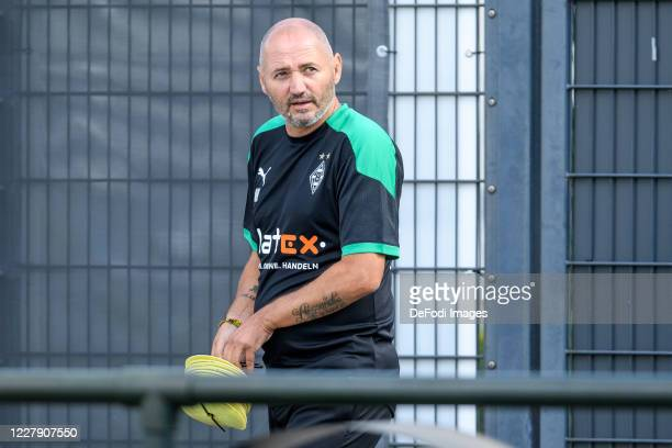 Assistant coach Oliver Neuville of Borussia Moenchengladbach looks on during the first training session after the summer break on August 04, 2020 in...