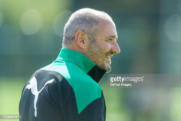 Assistant coach Oliver Neuville of Borussia Moenchengladbach smiles during day 2 of the pre-season summer training camp of Borussia Moenchengladbach...