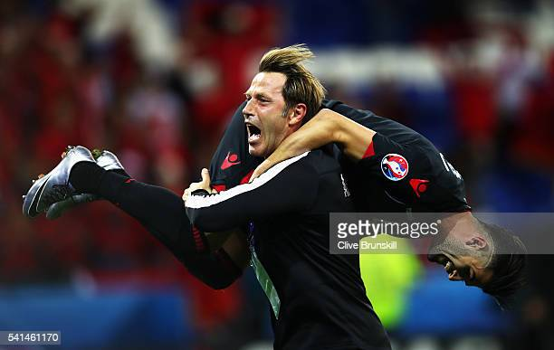 Assistant coach Paolo Tramezzani of Albania holding Elseid Hysaj celebrates their 10 win after the UEFA EURO 2016 Group A match between Romania and...