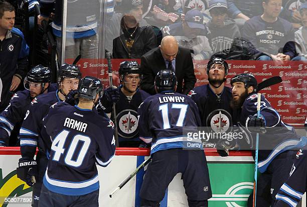 Assistant Coach Pascal Vincent of the Winnipeg Jets draws up a play during a second period stoppage in action against the Dallas Stars at the MTS...