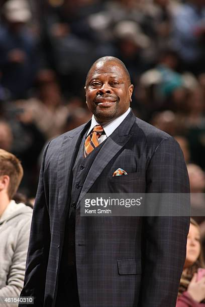 Assistant Coach Patrick Ewing of the Charlotte Hornets smiles during the game against the San Antonio Spurs at the Time Warner Cable Arena on January...
