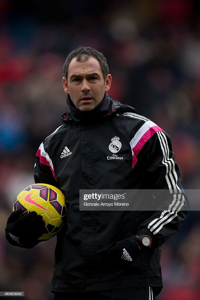 Assistant coach Paul Clement of Real Madrid CF holds the ball during his team warming up prior to start the La Liga match between Club Atletico de Madrid and Real Madrid CF at Vicente Calderon Stadium on February 7, 2015 in Madrid, Spain.