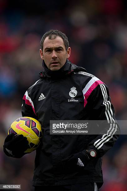 Assistant coach Paul Clement of Real Madrid CF holds the ball during his team warming up prior to start the La Liga match between Club Atletico de...