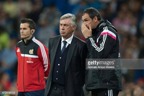 Assistant coach Paul Clement of Real Madrid CF speaks with his head coach Carlo Ancelotti during the La Liga match between Real Madrid CF and UD...