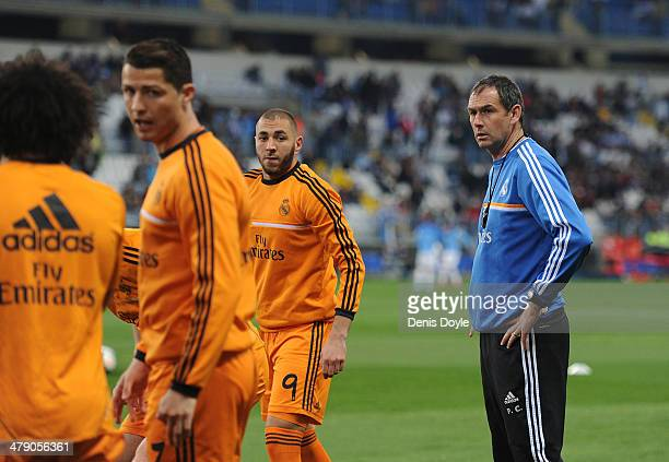 Assistant coach Paul Clement of Real Madrid FC Cristiano Ronaldo and Karmin Benzema warm up before their La Liga match between Malaga and Real Madrid...