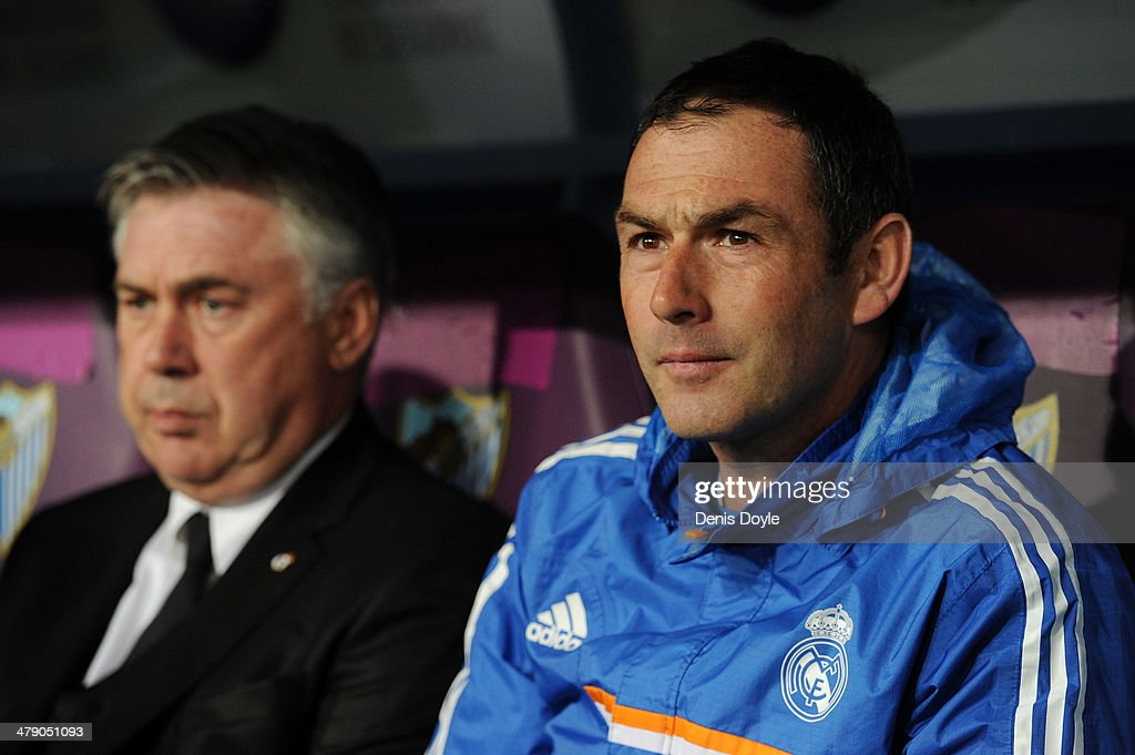 Assistant coach Paul Clement (R) sits beside head coach Carlo Ancelotti of Real Madrid FC during the La Liga match between Malaga and Real Madrid at La Rosaleda Stadium on March 15, 2014 in Malaga, Spain.