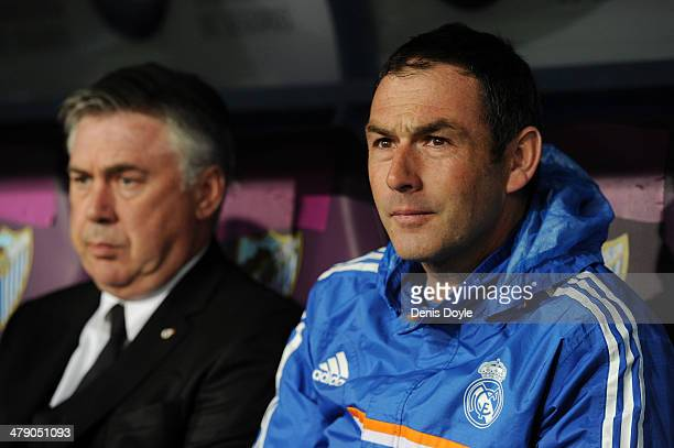 Assistant coach Paul Clement sits beside head coach Carlo Ancelotti of Real Madrid FC during the La Liga match between Malaga and Real Madrid at La...