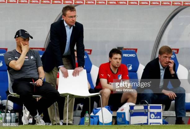 Assistant coach Peter Zeidler, head coach Ralf Rangnick, physiotherapist Peter Geigle and manager Jan Schindelmeiser of Hoffenheim react during the...