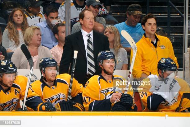 Assistant coach Phil Housley of the Nashville Predators coaches his team against the New York Islanders at the Bridgestone Arena on September 22 2013...