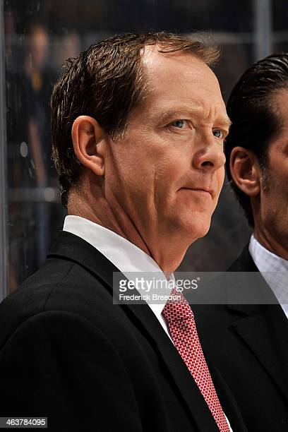 Assistant coach Phil Housley of the Nashville Predators watches his team warm up prior to a game against the Colorado Avalanche at Bridgestone Arena...