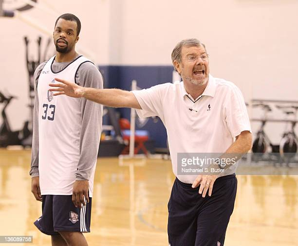 Assistant Coach PJ Carlesimo of the New Jersey Nets and player Shelden Williams during practice on December 23 2011 at the PNY Center in East...