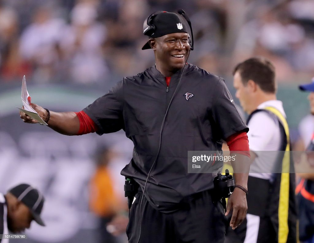 Assistant coach Raheem Mooris of the Atlanta Falcons reacts in the first half against the New York Jets during a preseason game at MetLife Stadium on August 10, 2018 in East Rutherford, New Jersey.