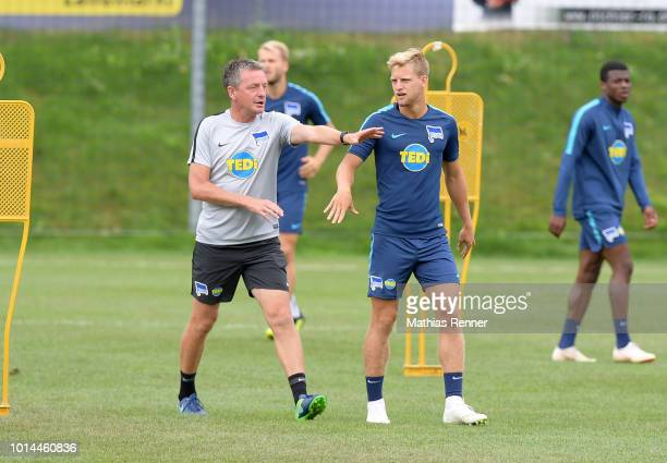 Assistant coach Rainer Widmayer and Arne Maier of Hertha BSC talk during the training camp on august 10 2018 in Schladming Austria