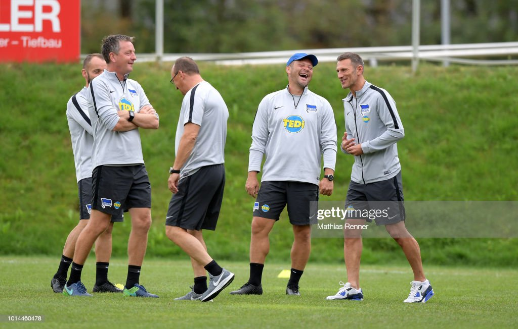 Assistant coach Rainer Widmayer, coach Pal Dardai and spokesman and Medien Marcus 'Max' Jung of Hertha BSC talk during the training camp on august 10, 2018 in Schladming, Austria.