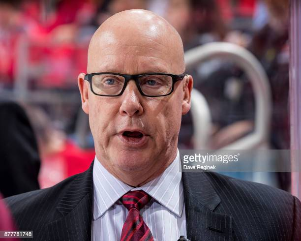 Assistant coach Ray Bennett of the Colorado Avalanche watches the action from the bench against the Detroit Red Wings during an NHL game at Little...