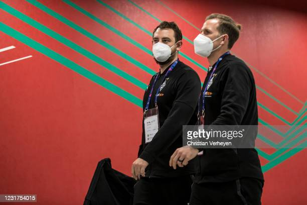 Assistant Coach Rene Maric and Athletic Coach Patrick Eibenberger of Borussia Moenchengladbach are seen before the UEFA Champions League Round Of 16...