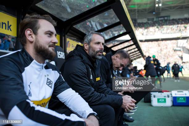Assistant Coach Rene Maric Head Coach Marco Rose and Assistant Coach Alexander Zickler of Borussia Moenchengladbach are seen during the Bundesliga...
