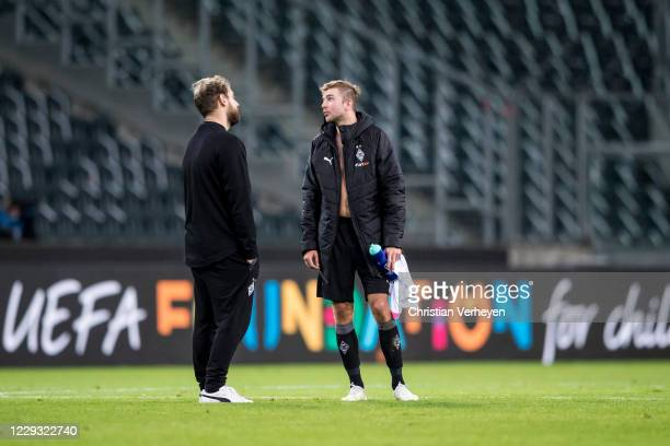 Assistant Coach Rene Maric of Borussia Moenchengladbach and Christoph Kramer react after the Group B - UEFA Champions League match between Borussia...