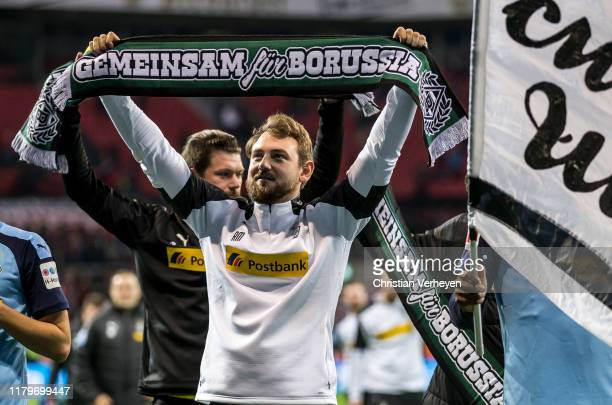 Assistant Coach Rene Maric of Borussia Moenchengladbach celebrate his teams win after the Bundesliga match between Bayer 04 Leverkusen and Borussia...
