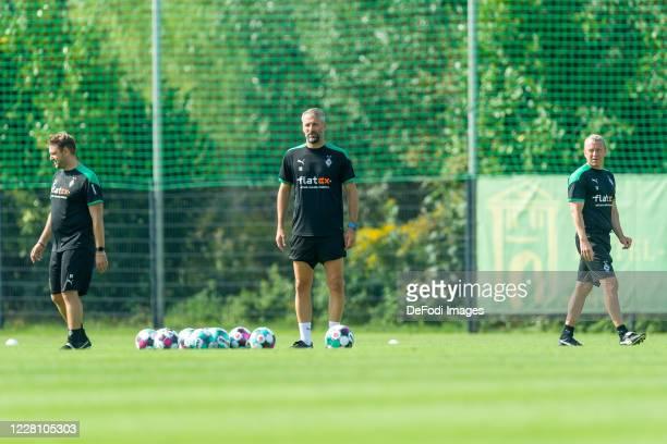 Assistant coach Rene Maric of Borussia Moenchengladbach, head coach Marco Rose of Borussia Moenchengladbach and assistant coach Frank Geideck of...