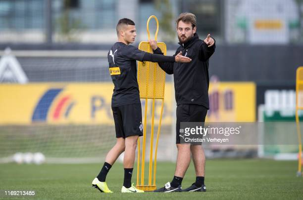 Assistant Coach Rene Maric of Borussia Moenchengladbach talks to Laszlo Benes during a Borussia Training session ahead the UEFA Europa League match...