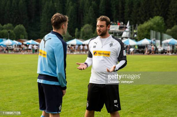 Assistant Coach Rene Maric talks to Louis Jordan Beyer of Borussia Moenchengladbach after the friendly match between Borussia Moenchengladbach and...