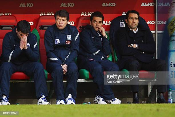 Assistant coach Rene Tretschok, head coach Otto Rehhagel, assistant coach Ante Covic and manager Michael Preetz of Berlin react during the Bundesliga...