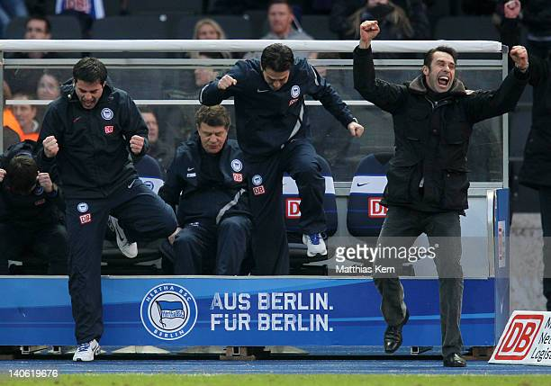 Assistant coach Rene Tretschok, head coach Otto Rehhagel, assistant coach Ante Covic and manager Michael Preetz jubilate after winning the Bundesliga...