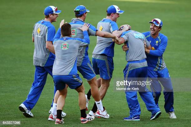 Assistant coach Ricky Ponting is congratulated by players during an Australia T20 training session at Adelaide Oval on February 21 2017 in Adelaide...