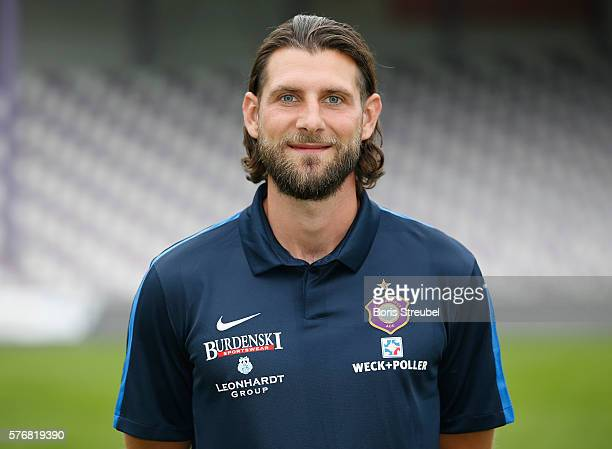 Assistant coach Robin Lenk poses during the FC Erzgebirge Aue Team Presentation at Sparkassenerzgebirgsstadion on July 17 2016 in Aue Germany