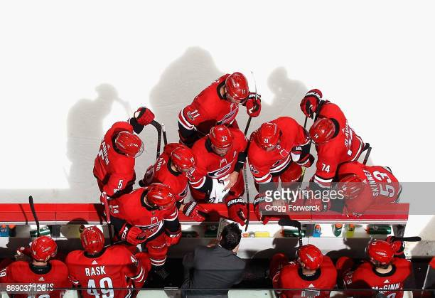 Assistant coach Rod Brind'Amour of the Carolina Hurricanes draws up a play prior to overtime against the St Louis Blues during an NHL game on October...