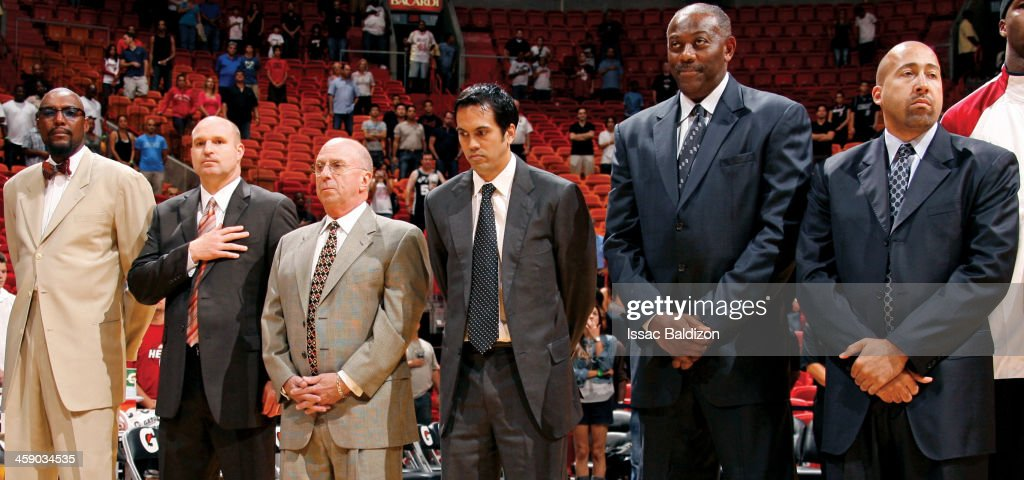 Assistant coach Ron Rothstein, head coach Erik Spoelstra, assistant coach Bob McAdoo and assistant coach David Fizdale of the Miami Heat stand on the court before the game against the San Antonio Spurs on October 11, 2009 at American Airlines Arena in Miami, Florida.