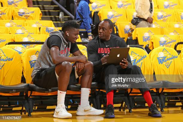 Assistant Coach Roy Rogers of the Houston Rockets speaks with Clint Capela during Game Five of the Western Conference Semifinals of the 2019 NBA...