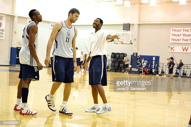 Assistant coach Sam Mitchell of the New Jersey Nets coaches Brook Lopez during practice on September 29 2010 at the PNY Center in East Rutherford New...