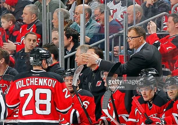 Assistant coach Scott Stevens of the New Jersey Devils gives instructions during a third period timeout against the Washington Capitals during the...