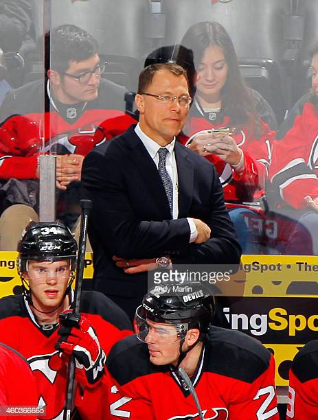 Assistant coach Scott Stevens of the New Jersey Devils looks on during the game against the Columbus Blue Jackets at the Prudential Center on...