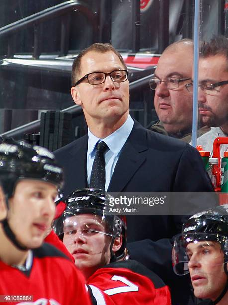 Assistant coach Scott Stevens of the New Jersey Devils looks on against the Montreal Canadiens during the game at the Prudential Center on January 2...