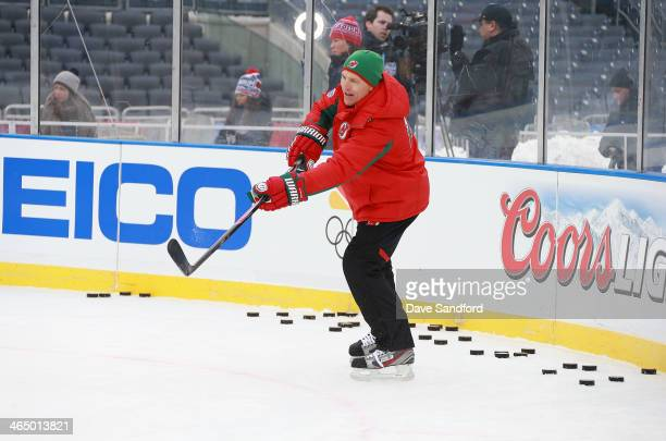 Assistant Coach Scott Stevens passes the puck during the 2014 NHL Stadium Series practice session at Yankee Stadium on January 25 2014 in New York...