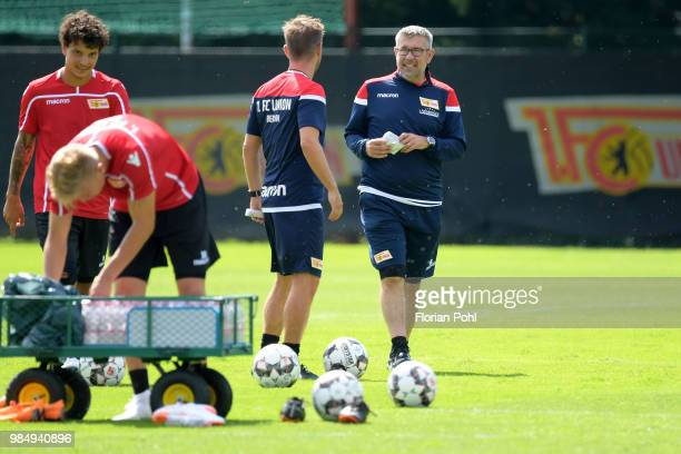 Assistant coach Sebastian Boenig and coach Urs Fischer of 1 FC Union Berlin speak during the first training of season 2018/2019 at Trainingsgelaende...
