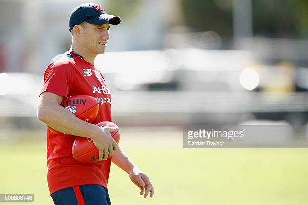 Assistant coach Simon Goodwin takes a Melbourne Demons AFL preseason training session at AAMI Park on December 11 2015 in Melbourne Australia