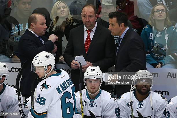 Assistant coach Steve Spott head coach Peter DeBoer and assistant coach Bob Boughner of the San Jose Sharks talk during a break in the action against...