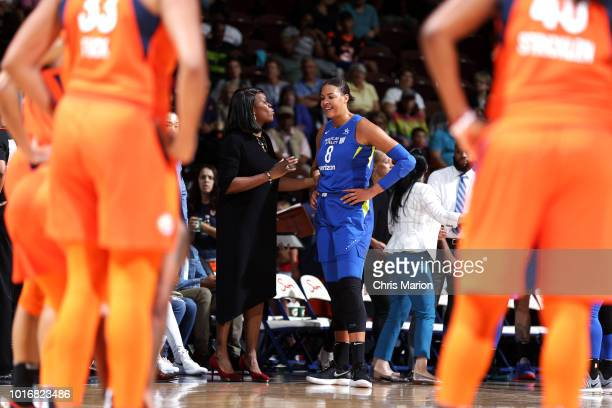 Assistant Coach Taj McWilliamsFranklin of the Dallas Wings speaks with Elizabeth Cambage of the Dallas Wings during the game against the Connecticut...