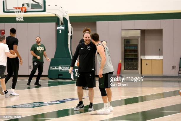 Assistant Coach Taylor Jenkins of Milwaukee Buck talks with Matthew Dellavedova of the Milwaukee Bucks during an allaccess practice on November 15...
