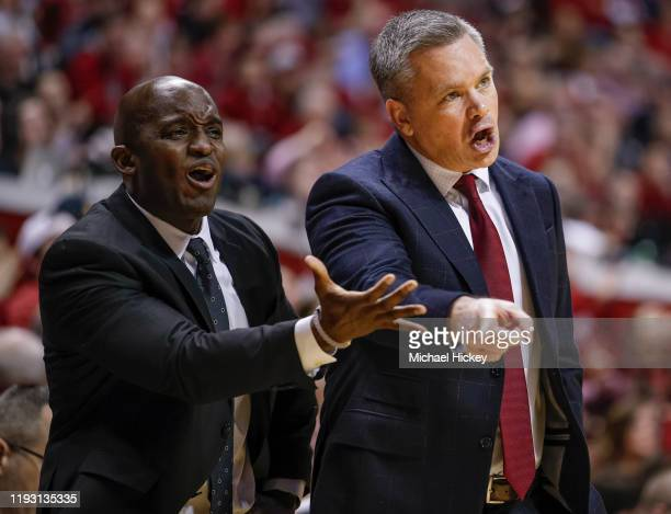 Assistant coach Terry Johnson and Head coach Chris Holtmann of the Ohio State Buckeyes are seen during the first half against the Indiana Hoosier at...