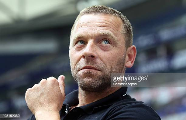Assistant coach Thomas Haessler of Koeln looks on during the LIGA total Cup 2010 third place playoff match between Hamburger SV and 1 FC Koeln at the...