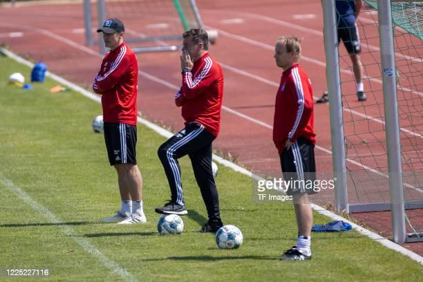 assistant coach Tobias Schweinsteiger head coach Dieter Hecking of Hamburger SV and goalkeeper coach Kai Rabe of Hamburger SV during the training...