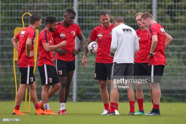 Assistant coach Tobias Zellner of Augsburg gives instructions to Simon Asta of Augsburg Marco Richter of Augsburg Sergio Cordova of Augsburg Julian...