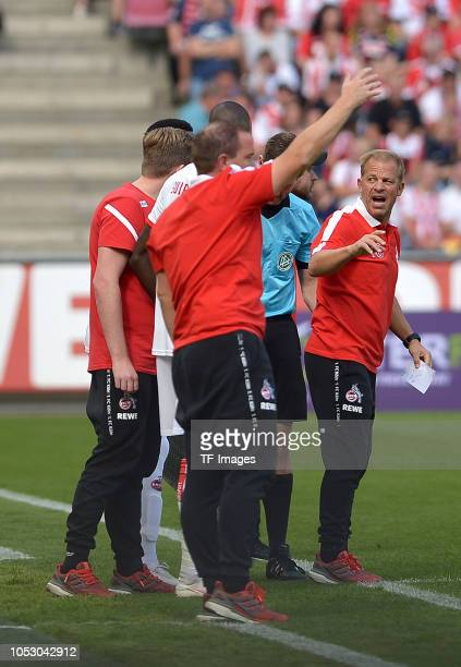Assistant coach Tom Cichon of Koeln and Head coach Markus Anfang of Koeln gesture during the Second Bundesliga match between 1 FC Koeln and SC...