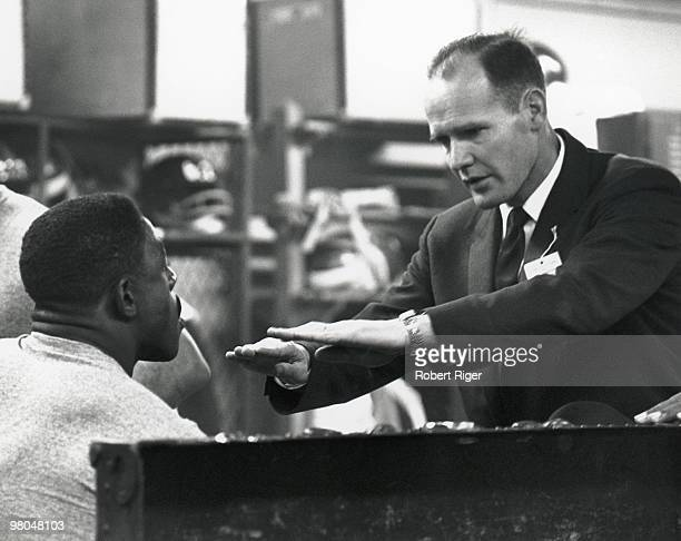 Assistant coach Tom Landry speaks with Roosevelt Brown before the game against the Baltimore Colts in the 1959 NFL Championship at Memorial Stadium...