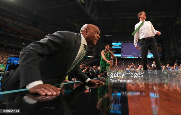 Assistant coach Tony Stubblefield and head coach Dana Altman of the Oregon Ducks look on as Tyler Dorsey comes off the bench in the first half...